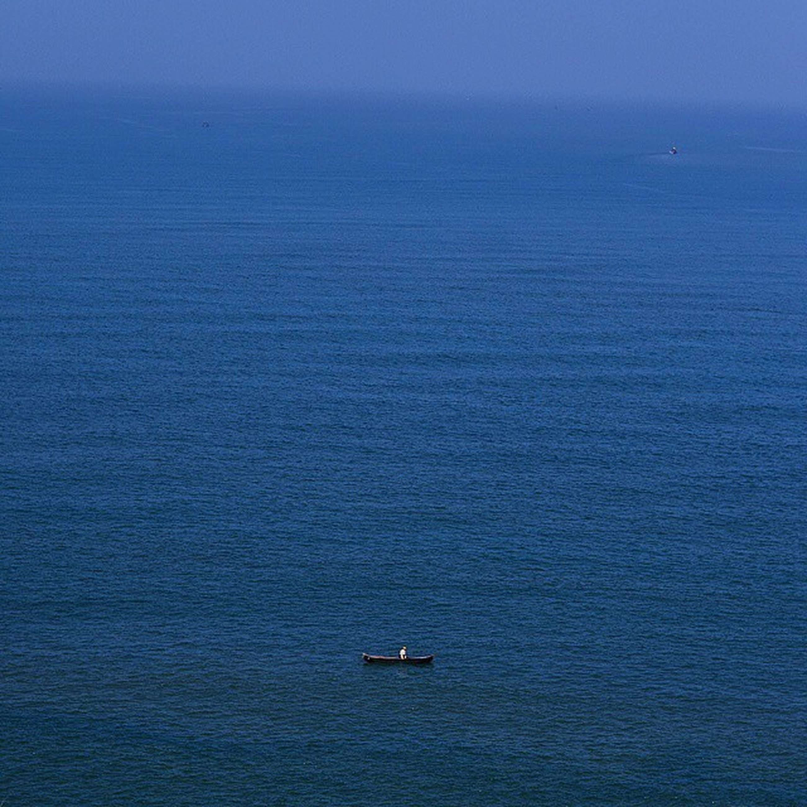 sea, water, waterfront, nautical vessel, transportation, boat, mode of transport, blue, horizon over water, tranquil scene, tranquility, rippled, scenics, beauty in nature, nature, sailing, seascape, idyllic, ocean, copy space