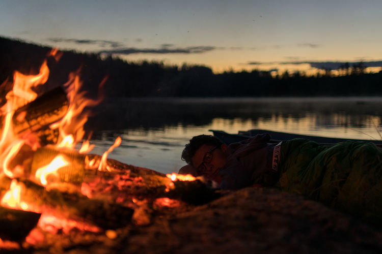 Beauty In Nature Campfire Camping Fire Idyllic Lake Nature Nature Non-urban Scene Reflection Sky Sleeping Bag Sunset Sweden Tranquil Scene Water People And Places