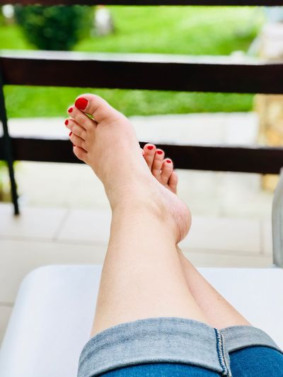 Barefoot Human Body Part One Person Low Section Human Leg Nail Polish Body Part Real People Women Adult Human Foot Lifestyles barefoot Nail Personal Perspective Indoors  Relaxation Leisure Activity Home Interior Red Nail Polish Human Limb