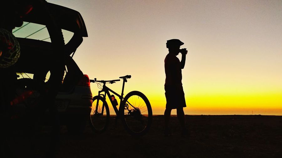 Doha Qatar Doha Qatar Cycling Dawn Of A New Day Dawn Daybreak Eyeem Philippines Trek Bikes Race Day Sunrise Sunrise_sunsets_aroundworld Headwear Full Length Standing Bicycle Men Silhouette Mountain Bike Sports Helmet Sportsman Land Vehicle Vehicle