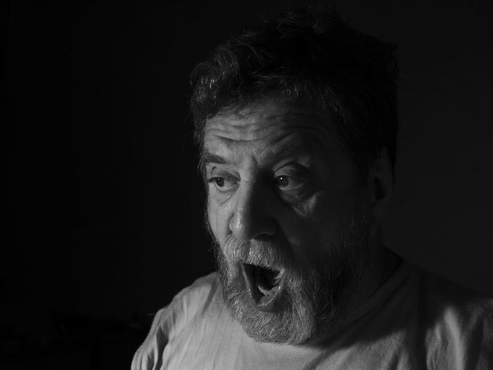 surprised middle-aged bearded man Bearded Black And White Black Background Casual Clothing Caucasian Close-up Dark Darkroom Front View Headshot Leisure Activity Lifestyles Looking At Camera Low Light Man Mature Adult Middle-aged Person Sad Studio Shot Surprised Young Adult Young Men