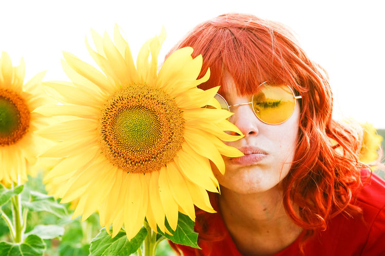Close-up of woman with sunflower