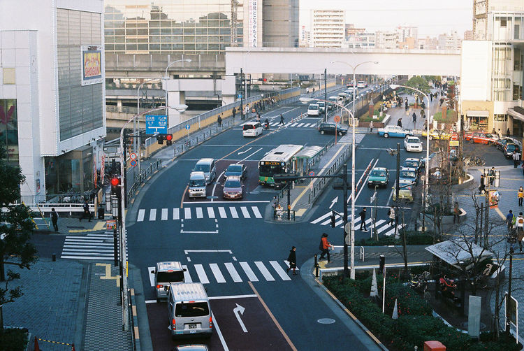 Architecture Building Exterior Built Structure Car City City Street Cityscape Crossing Crosswalk High Angle View Land Vehicle Marking Mode Of Transportation Motor Vehicle Outdoors Road Road Marking Sign Street Symbol Transportation Zebra Crossing EyeEmNewHere