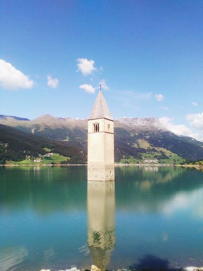Mountain Place Of Worship Blue Water Religion Reflection Lake History Sky Architecture Cross Shape Bell Tower - Tower Bell Tower Tower