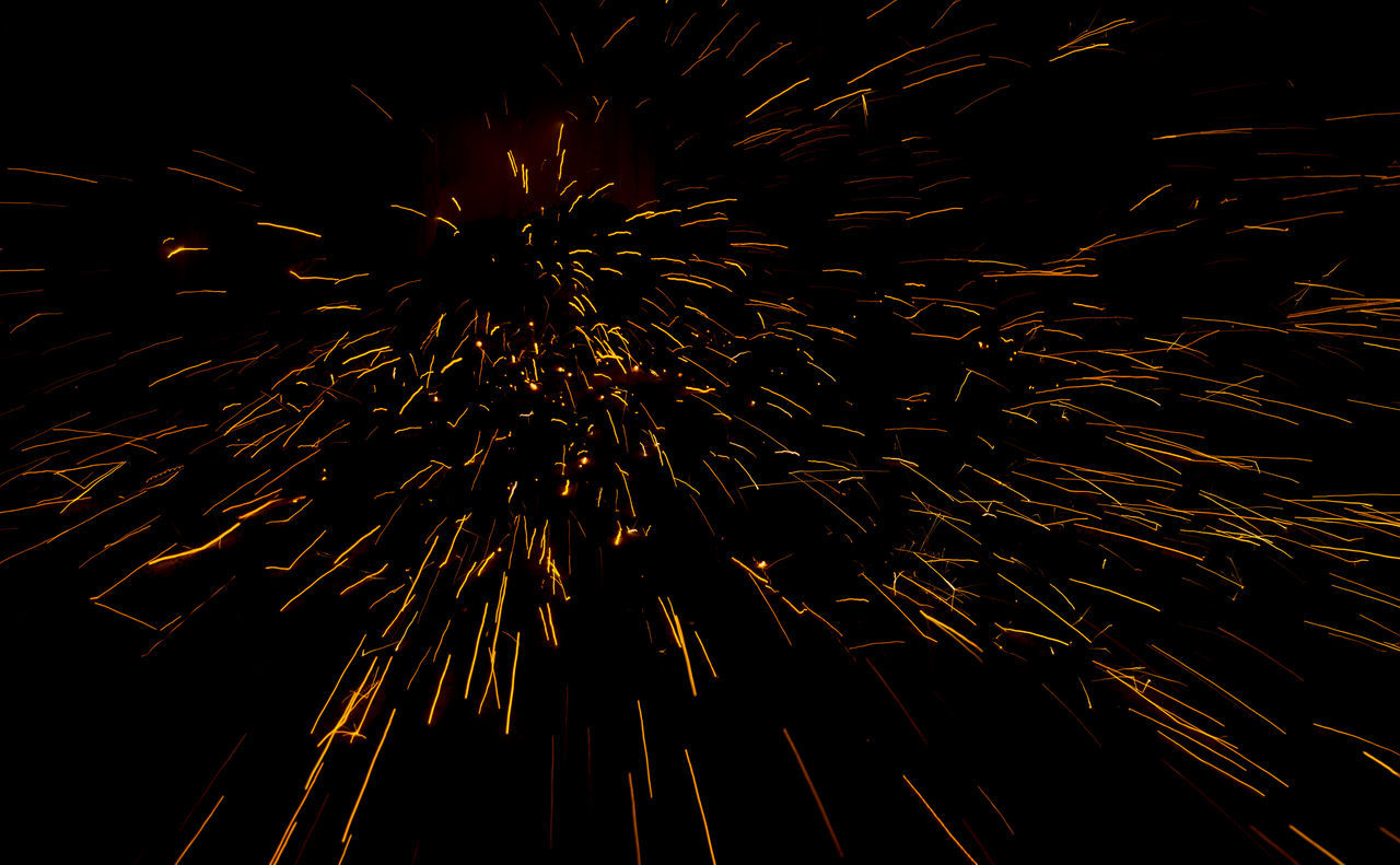 night, firework display, celebration, exploding, long exposure, firework - man made object, glowing, low angle view, motion, blurred motion, arts culture and entertainment, no people, illuminated, event, full frame, outdoors, sky