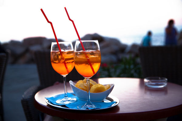 Aperol Spritz Alcohol Business Close-up Drink Drinking Glass Enjoy Focus On Foreground Food Food And Drink Freshness Glass Glass - Material Longdrink Orange Color Outdoors Plate Refreshment Restaurant Serving Size Snack Straws Style Table Transparent