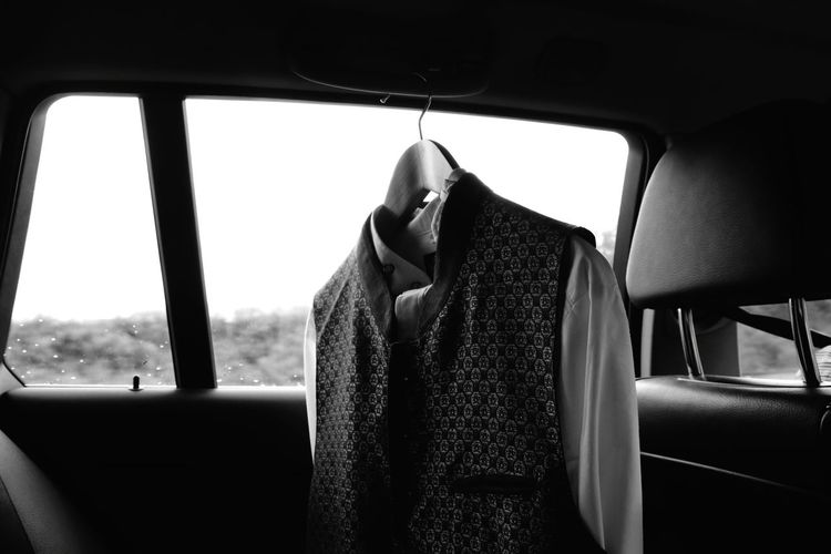 hangers with clothes in a car