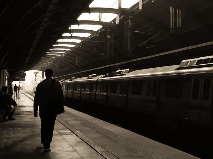 People at railroad station platform