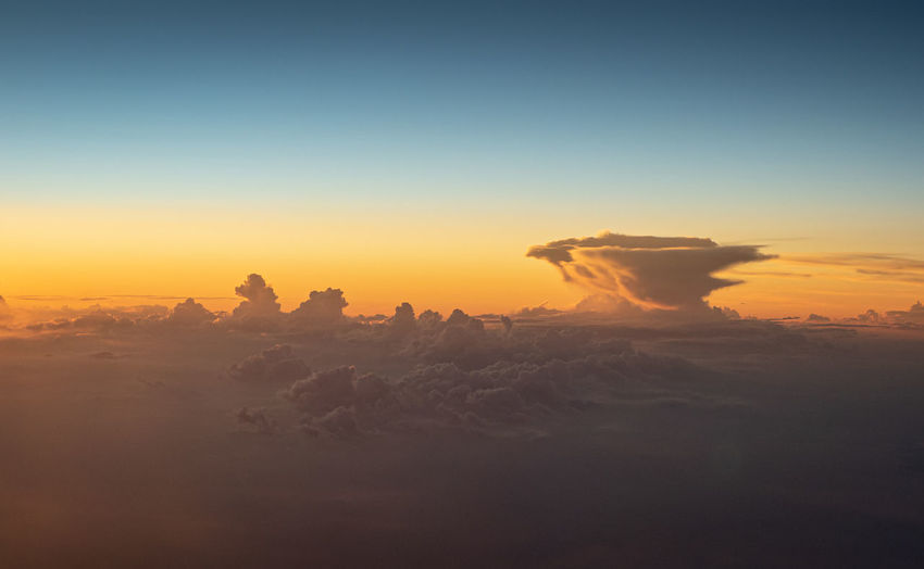 Cirrus and some distant cumulus and cumulonimbus south of saint-tropez at sunset