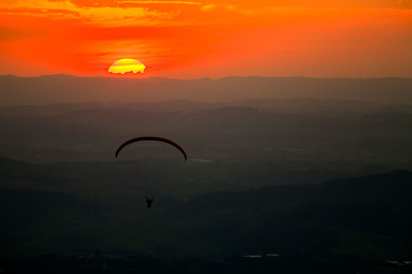Freedom Liberty Nature Adventure Adventure Sports Beauty In Nature Day Extreme Sports Mid-air Mountain Nature Orange Color Outdoors Parachute Paragliding People Radical Sport Scenics Silhouette Sky Sun Sunrise Sunset Tranquility