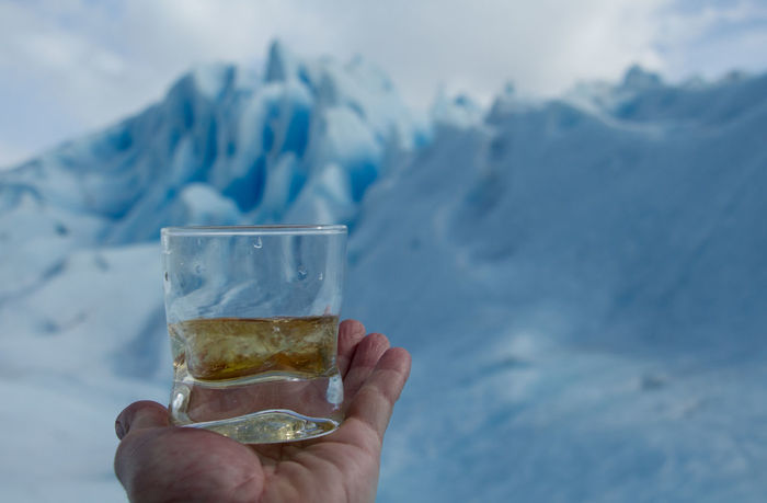 Human Hand Cold Temperature Drink Human Body Part Snow Refreshment Winter Drinking Glass Adult Ice People Close-up One Person Wiskhy Glacier Perito Moreno. Patagonia. Argentina. Scenics Outdoors Frozen Ice