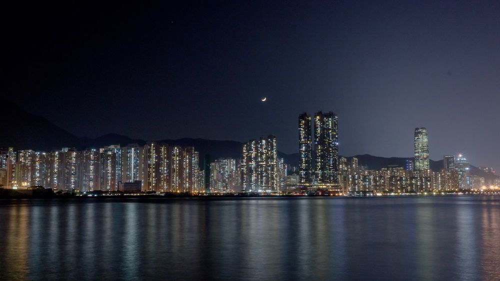 Lighted Coast Hong Kong Sha Tin Skyscraper Cityscapes Nightphotography Night Lights Long Exposure Built Structure Illuminated Sea Ocean OceanCity Ocean View Ocean Front Travel Destinations Unseen Water Sky Moonlight Moon Reflection Travel Travel Photography Marina Lei Yue Mun Fishing Village Connected By Travel