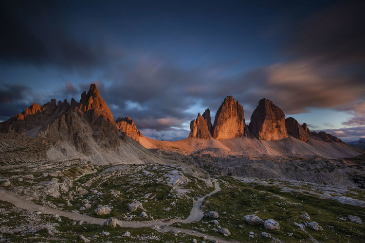 Sunset at Tre Cime di Lavaredo, Dolomites, Italy Dolomites, Italy Beauty In Nature Cloud - Sky Environment Formation Land Landscape Mountain Mountain Peak Mountain Range Nature No People Non-urban Scene Outdoors Remote Rock Rock - Object Scenics - Nature Sky Solid Sunset Tranquil Scene Tranquility
