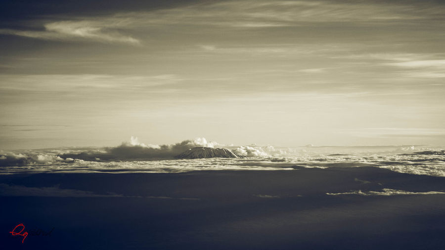 Kilimanjaro In The Clouds Aerial View Beach Beauty In Nature Cloud - Sky Day Environment Idyllic Kilimanjaro Land Landscape Nature No People Outdoors Scenics - Nature Sea Sky Tranquil Scene Tranquility Water