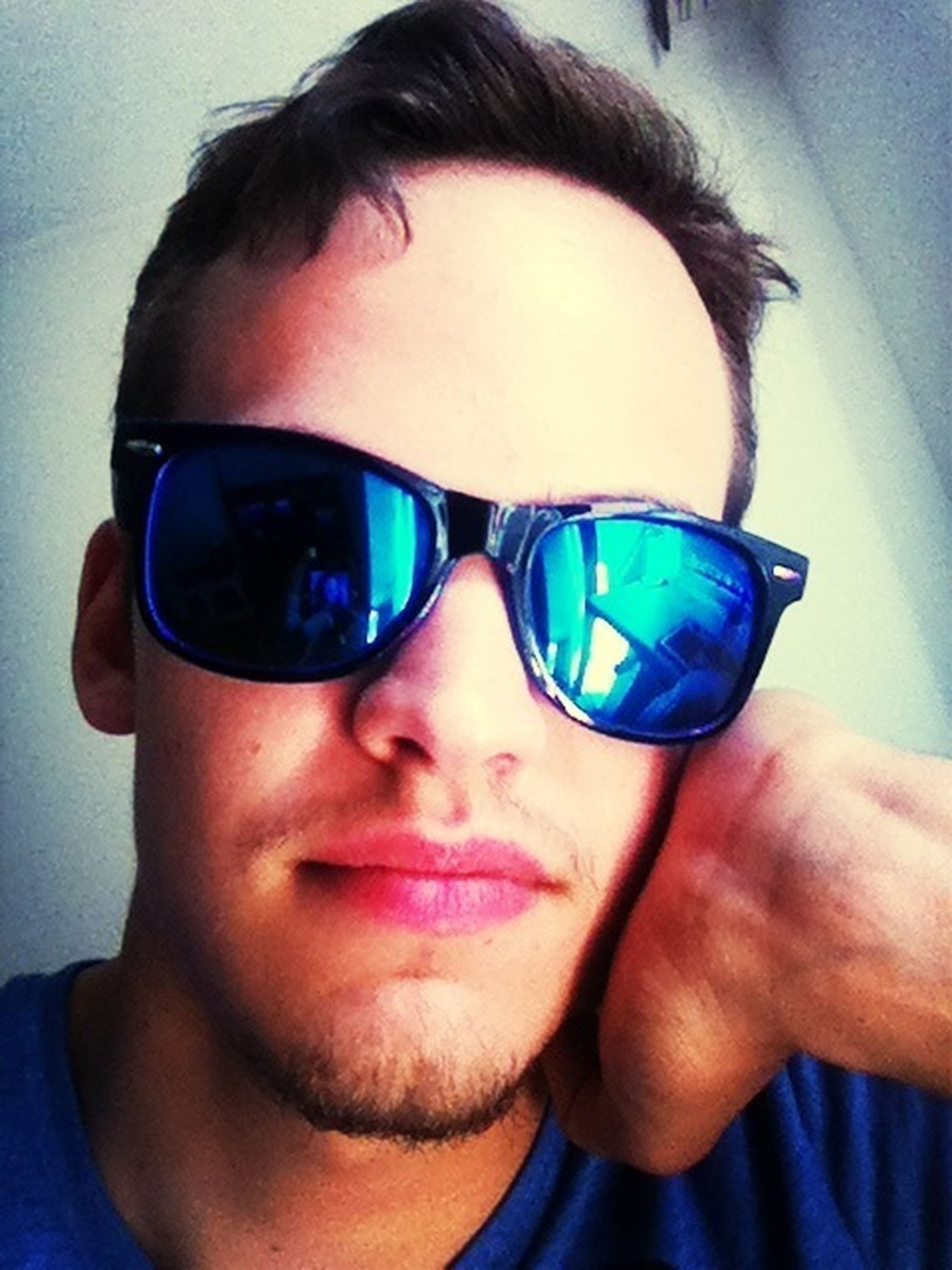 portrait, looking at camera, sunglasses, person, lifestyles, headshot, leisure activity, front view, young adult, close-up, reflection, young men, head and shoulders, smiling, eyeglasses, blue, human face