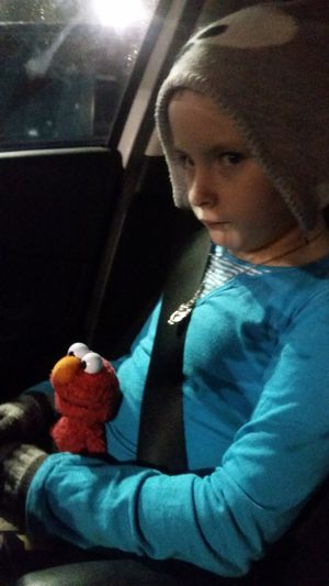Elmo buckled in and riding shotgun with Thelilian .