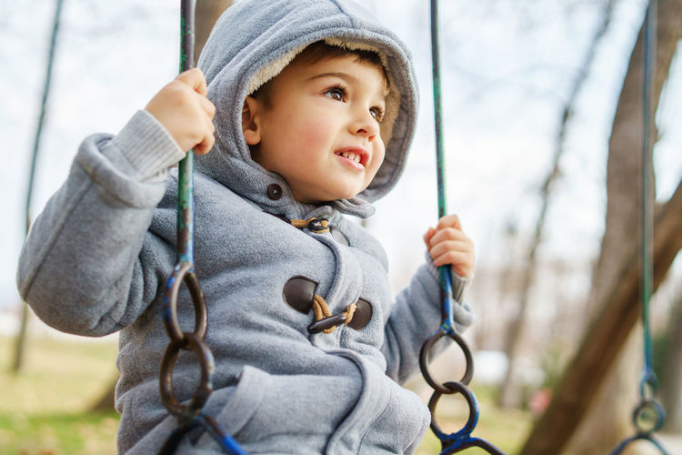 Portrait of cute boy looking at playground
