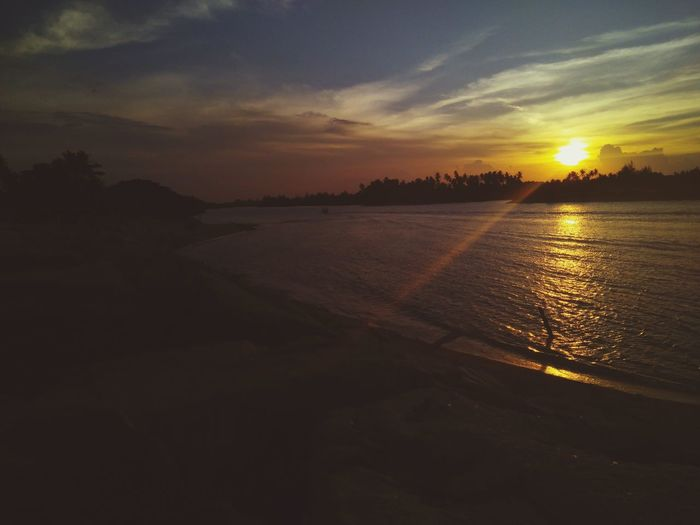 PANTAI SENOK Reflection sea water beach cloud - sky no people first eyeem photo Reflection Sea Water Beach No People Sunset