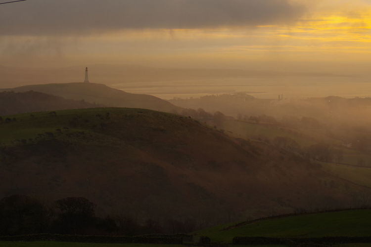 Fog Foggy Morning Hoad Monument Ulverston Fog Landscape Tourism Sunset Travel Outdoors Social Issues Nature Mountain Beauty Grass Dawn Sky No People Beauty In Nature