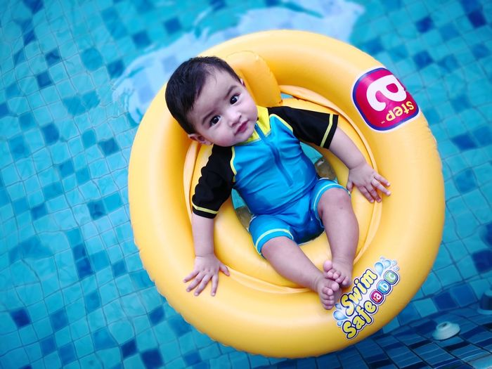 Infant Swimming Water Floating EyeEm Selects Water Child Water Slide Swimming Pool Smiling Full Length Portrait Happiness Childhood Yellow