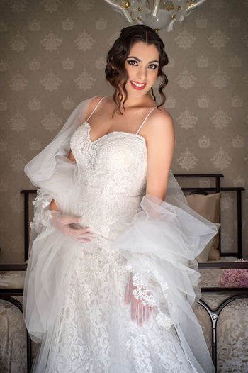 Adult Beautiful Woman Beauty Bride Celebration Clothing Dress Event Fashion Hairstyle Indoors  Looking At Camera Newlywed One Person Portrait Three Quarter Length Wedding Wedding Dress Women Young Adult Young Women