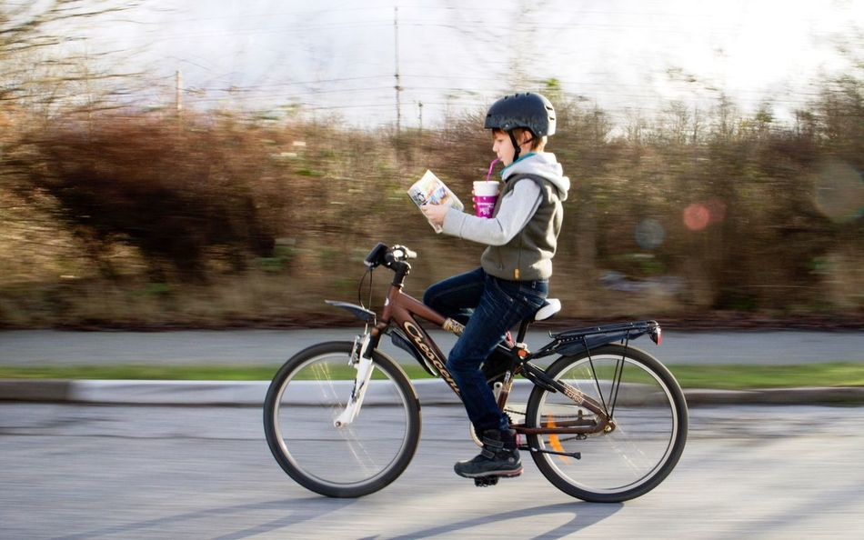 Enjoy The New Normal Bicycle On The Move Outdoors Cycling Transportation Speed Motion Day Healthy Lifestyle Helmet Multitasking Bike Without Hands Multitask Multitasking...