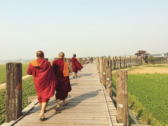 Near Far Bridge Novice Buddah Robe Clear Sky Spirituality Walking Red Be. Ready. Men Full Length Outdoors Day Togetherness Real People Nature Boys Sky Adult People Adventures In The City