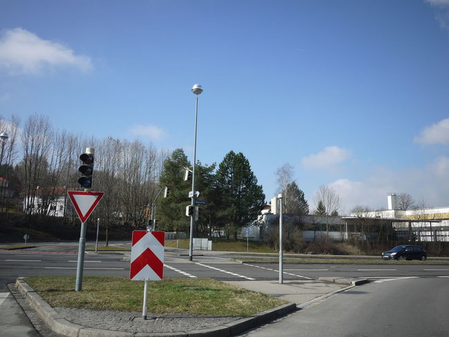 Trafficsign in south Germany Allgäu Guiding Traffic Cloud - Sky Communication Day Guidance Guide No People Outdoors Road Road Sign Sky Street Light Traffic Sign Transportation Tree Warning Sign
