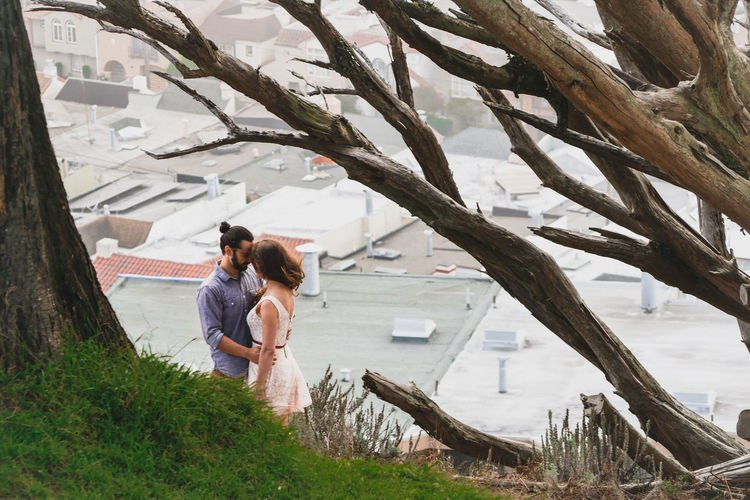 Couple Romancing By Tree In City