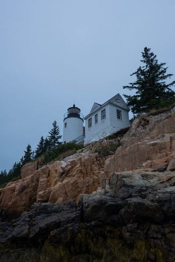 Bass Harbor Ocean Landscape Nature Moody Adventure Bass Harbor Lighthouse Lighthouse Maine Fujifilm Cloudy Overcast National Park Acadia Building Exterior Built Structure Architecture Sky Building Plant Tree Nature Low Angle View No People Rock Day Solid Land House Copy Space Outdoors First Eyeem Photo