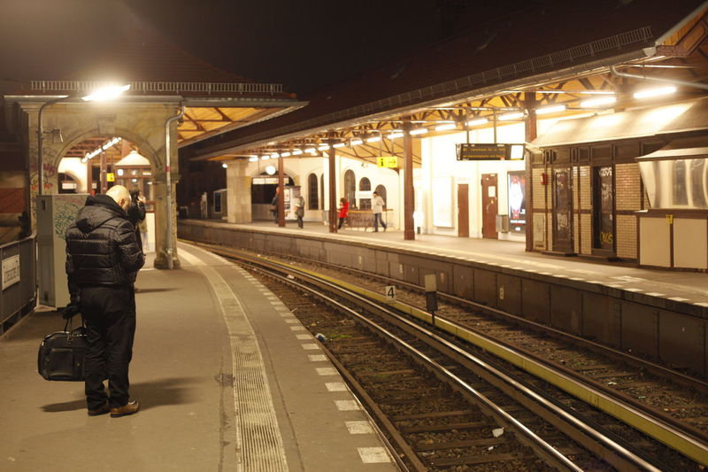 Adult Full Length Illuminated Lifestyles Men Mode Of Transport Night One Person Outdoors People Public Transportation Rail Transportation Railroad Station Railroad Station Platform Railroad Track Real People Schlesisches Tor Transportation U Bahnhof