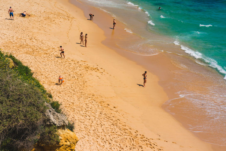 Aerial view of eople on the beach. Aerial Shot Beach Life Relaxing Shadows & Lights Swell Travel Clear Blue Water Ocean Summer Sun Vacation Vacation Photography Waves Website Background Yellow Beach Yellow Sand