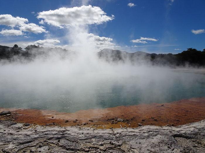 Smoke emitting from geyser against sky
