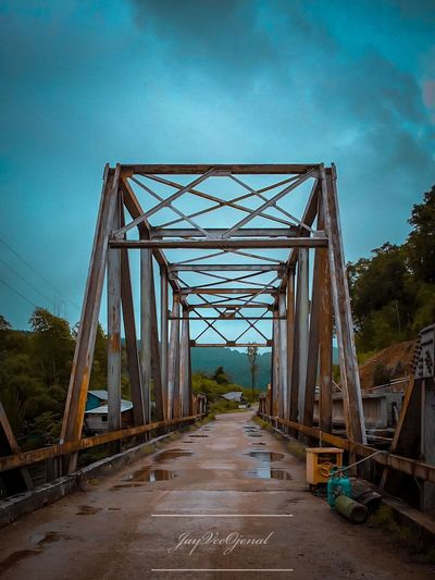 Road trip to busyanga Connection Bridge - Man Made Structure Bridge Architecture Built Structure Sky The Great Outdoors - 2018 EyeEm Awards The Way Forward Travel Destinations Diminishing Perspective Outdoors Cloud - Sky Metal No People Road Nature Direction Transportation Day Blue Long