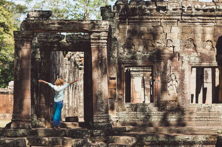 Siem Reap Cambodia Angkor Curly Hair Girl Architecture Built Structure History The Past One Person Building Exterior Building Day Old Ruin Religion Standing Spirituality Place Of Worship Ancient Architectural Column Old Real People Belief Travel Human Arm Outdoors Arms Raised Ancient Civilization