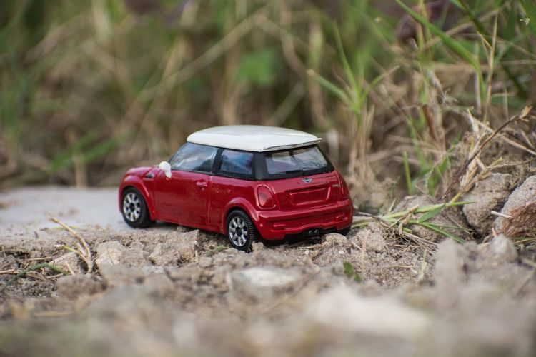 Close-up of toy car on dirt