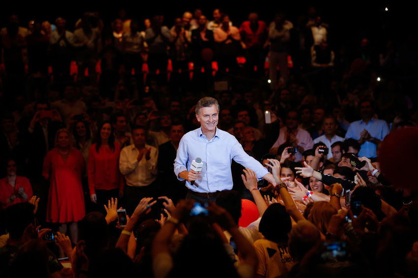 Mauricio Macri, president of the Argentina republic greets his supporters during a ceremony held in Cordoba Argentina Casual Clothing Crowd Enjoyment Illuminated Large Group Of People Mauricio Macri Night Presidential Campaign 2016 Presidential Election 2016