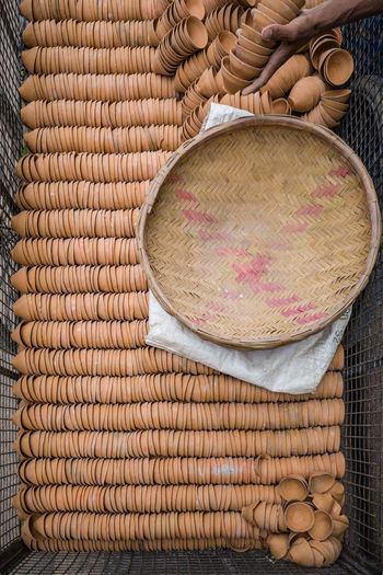 Directly above shot of wicker basket on diyas in metal container