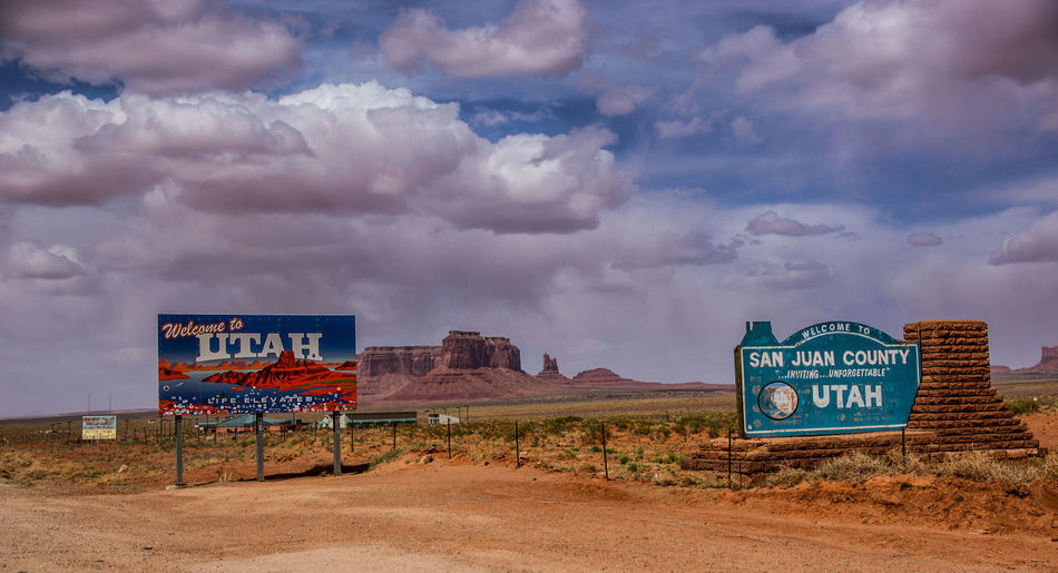 Arid Climate Cloud - Sky Clouds And Sky Cloudy Information Sign Outdoors Rockformations Sign Board Sky Western Script