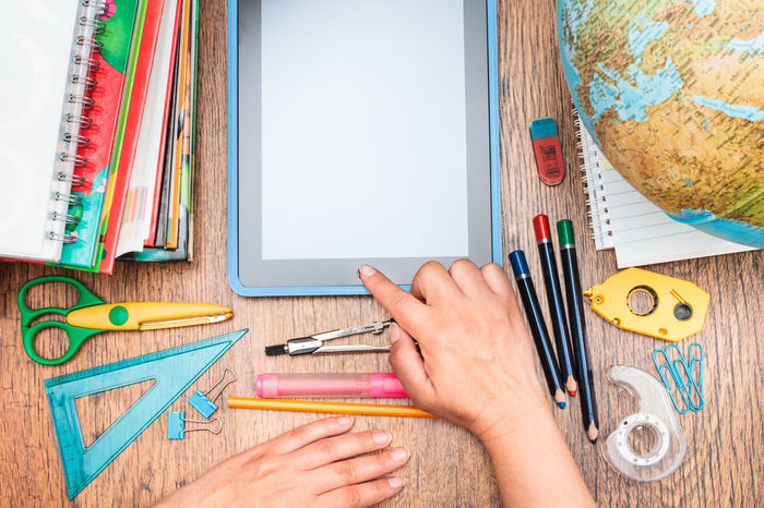 School accessories on a desktop Accessories Book Compass Copy Space Crayon Crayons Day Desktop Education Many Notebook Object Organized Pen Pencil Pencils Rubber Ruler School Scissors Still Life Study Supply Table Top View