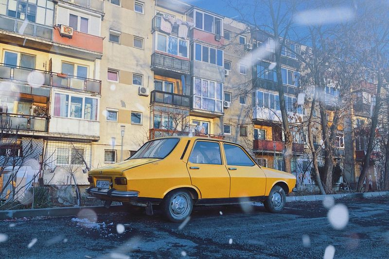Defying blizzard ❄️... Weather Condition Iconic Retro Car Automobile Auto Asphalt City Urban Dacia 1300 Dacia Vintage Car Blizzard Snowflake Snowing Building Exterior Built Structure Architecture Mode Of Transportation Transportation City Building Car Motor Vehicle Land Vehicle Street Taxi Residential District Yellow Taxi Winter Snow