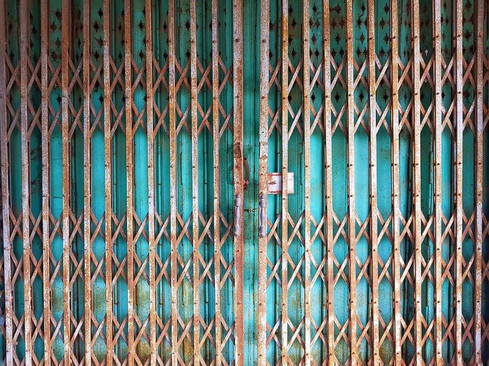 Full frame shot of rusty metallic gate