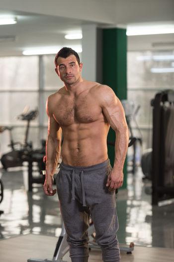 Portrait of shirtless man standing