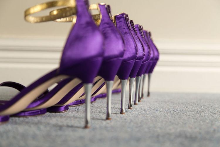 Row Of Purple High Heels On Carpet