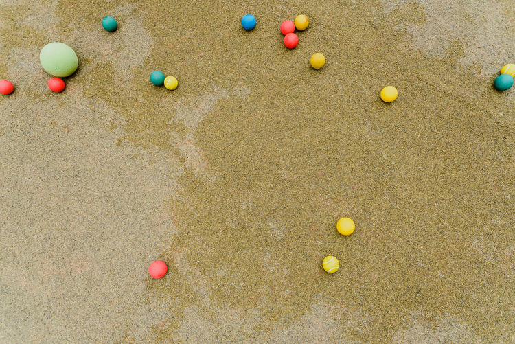 High angle view of multi colored ball on sand