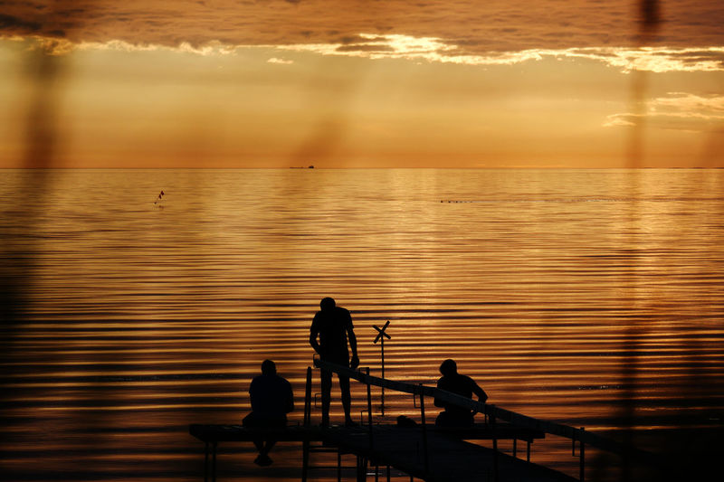 Beauty In Nature Golden Moment Idyllic Leisure Activity Lifestyles Nature Orange Color Outdoors Outline Reflection Rippled Scenics Silhouette Sky Sun Sunset Tranquil Scene Tranquility Water 43 Golden Moments Color Palette