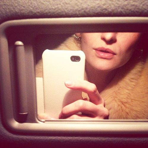 Close-up of woman taking selfie