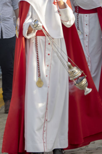 Incense in spanish easter Clothing Midsection Real People Red Arts Culture And Entertainment Group Of People Holding Day Traditional Clothing Celebration People Standing Unrecognizable Person Event Performance Festival Easter In Spain Incense Smoke Spanish Easter Religion Catholic