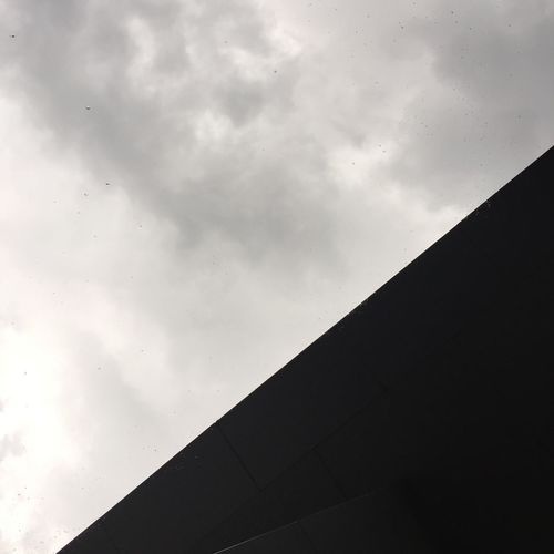 High section of built structure against sky