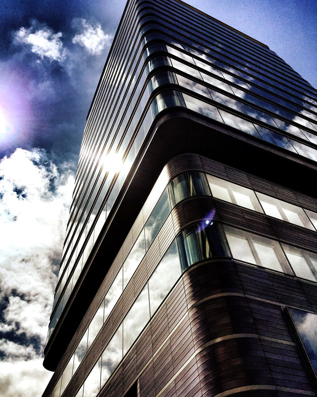 building exterior, low angle view, architecture, built structure, sky, modern, outdoors, no people, day, city, skyscraper